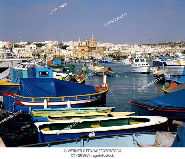 Malta, Marsaxlokk, fishing port, fishing boats , Luzzi, church