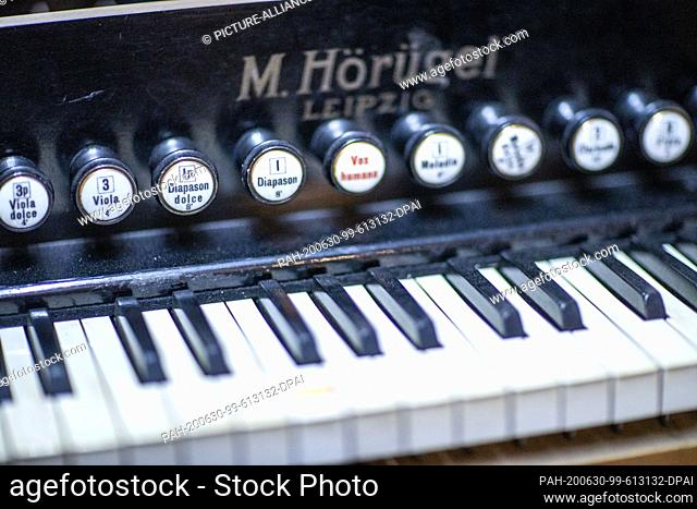 "22 June 2020, Mecklenburg-Western Pomerania, Rostock: The keyboard of a harmonium from the 1930s is restored in the workshop """"Historical Keyboard Instruments -..."