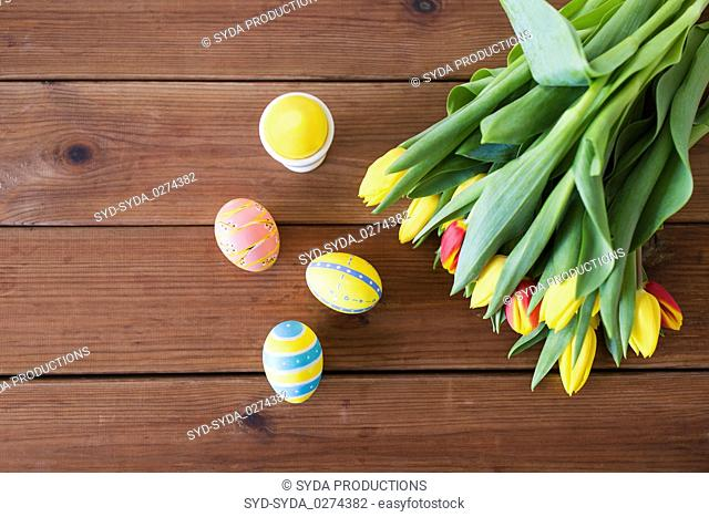 colored easter eggs and tulip flowers