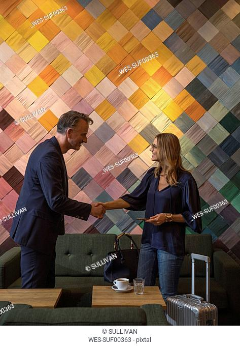 Two business people having meeting in a cafe