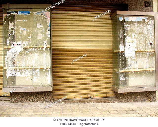 Empty shop windows of a closed shop, Lleida, Catalonia, Spain