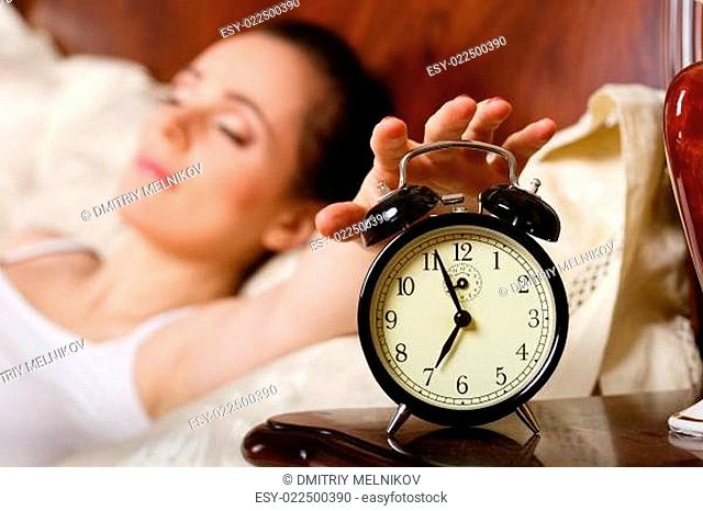 Young woman sleeps in bed in the bedroom