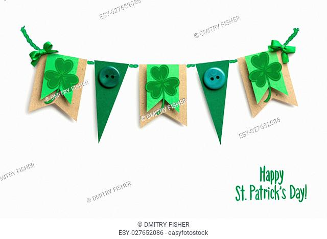 Creative St. Patricks Day concept photo of flags with shamrocks made of paper on white background