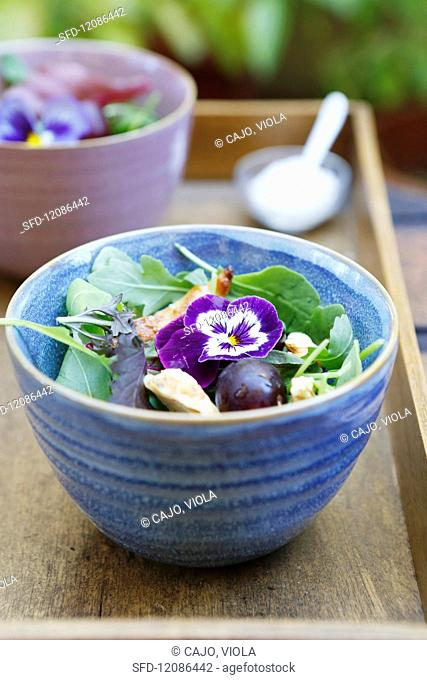 Chicken and grape salad with edible flowers