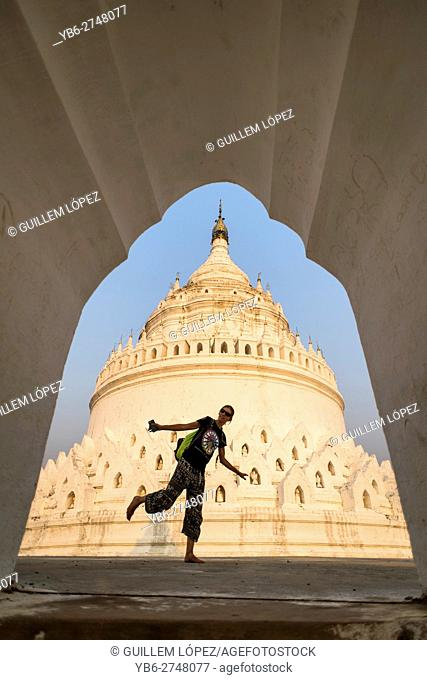 A female tourist walks around the Hsinbyume Pagoda, Mingun, Sagaing, Myanmar