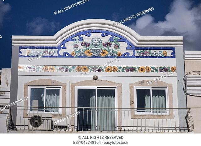 Outdoor view of the main architecture style of buildinds in the Algarve with beautiful azulejo artwork
