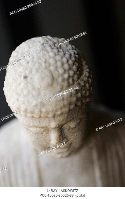 Close-up on the head of a Buddha sculpture