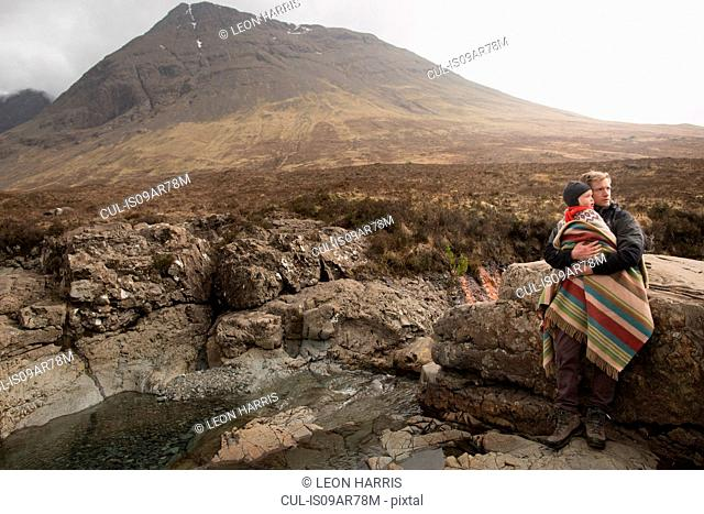 Father holding son, Fairy Pools, Isle of Skye, Hebrides, Scotland