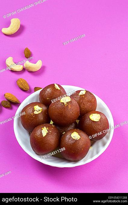 Indian Dessert : Gulab Jamun in white bowl