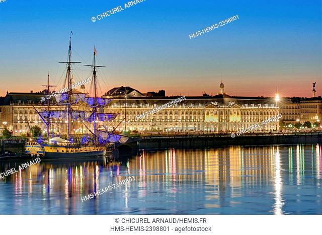 France, Gironde, area listed as World Heritage by UNESCO, the banks of the Garonne river with Hermione sailboat and the buildings of Bourse square