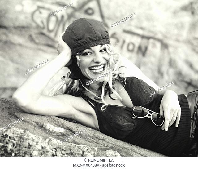 Woman lying on ground laughing
