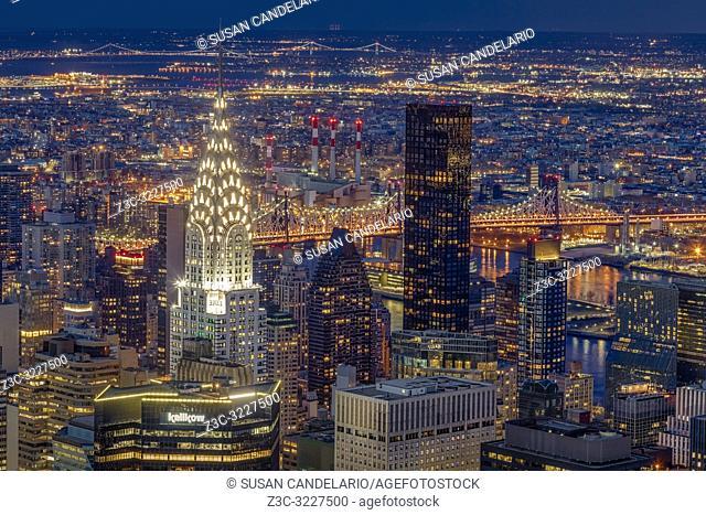 Chrysler Building NYC Twilight - Upper view to the illuminated midtown Manhattan skyline including the iconic art deco Chrysler building along with the Ed Koch...