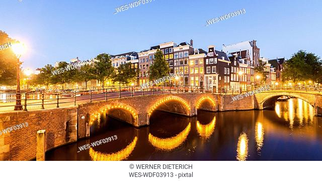 Netherlands, Amsterdam, lighted bridges over Emperor's Canal and Leidse Canal in the evening