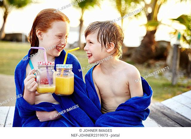 Boy and girl wrapped in towels