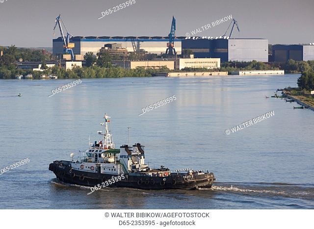 Romania, Danube River Delta, Tulcea, elevated view of tugboat on the Danube River, dawn