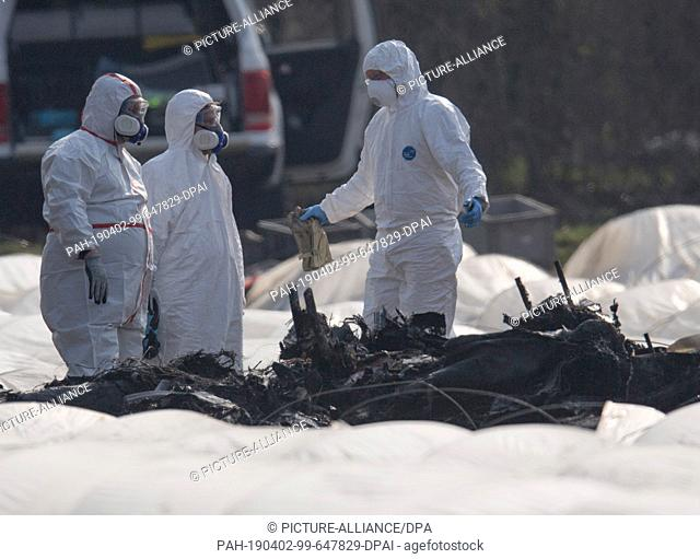 02 April 2019, Hessen, Erzhausen: Experts for aircraft accidents are investigating the burnt-out wreckage of a business aircraft near the Egelsbach airfield