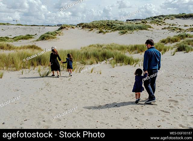 Family with two little children walking in the dunes, The Hague, Netherlands