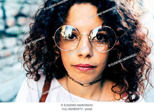 Woman in round large rimmed glasses, Milan, Italy