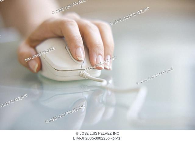 Woman using a computer mouse