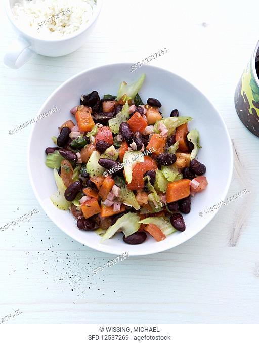 Kidney beans with spring onions, peppers, ham, celery and rice