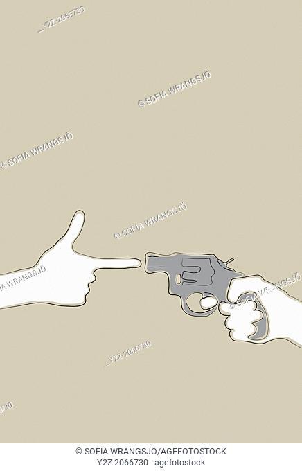 Hand making gun gesture pointing at a revolver