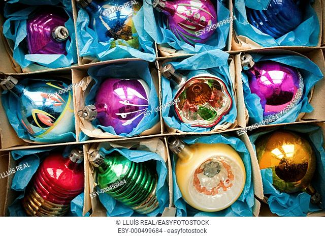 Cardboard box full of vintage Christmas decorations