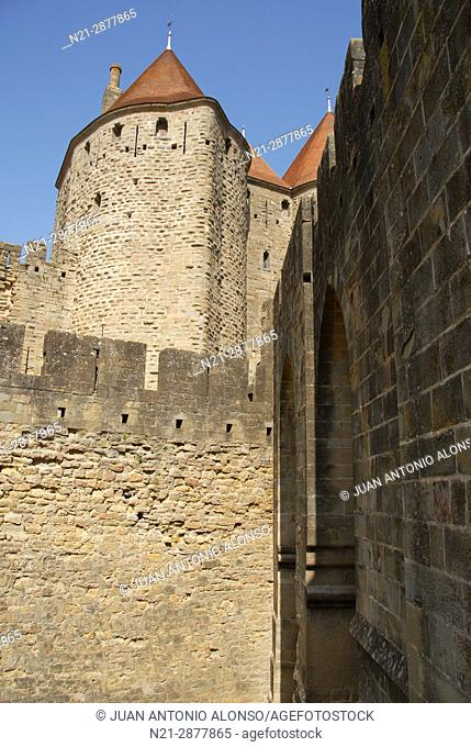 Partial view of the towers that compose the Narbonne Gate to the fortified city of Carcassonne. Languedoc - Roussillon. France, Europe