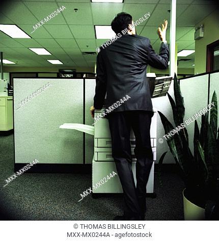 man using photocopier