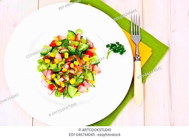 Salad of Celery, Crab Stick, Cucumber, Corn and Dill Studio Photo