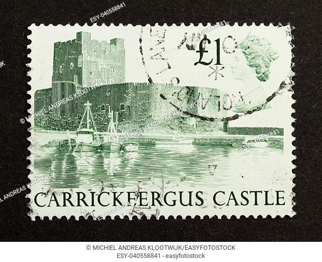 ENGLAND - CIRCA 1980: Stamp printed in the UK shows Carrickfergus Castle, circa 1980