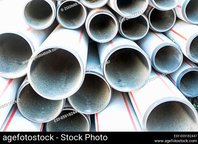 large pile of replacement pipes for sanitary installations up close