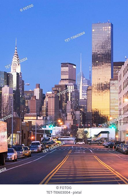 USA, New York State, New York City, city street with skyscrapers in background