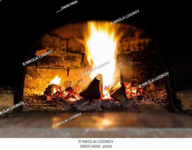 Horizontal vibrant fire in stove bokeh background backdrop