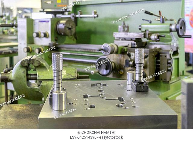 Machine workshop with lathe machine and bench vise
