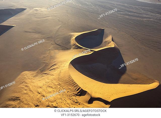 Aerial view of the sand dunes of Sossusvlei at sunset, Namib Naukluft national park, Namibia, Africa