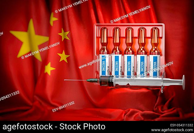 Vaccination in China concept. Syrringe and vials with vaccine on chinese flag. 3d illustration