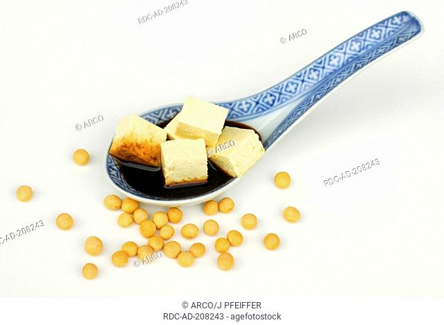 Tofu, cubed with soy sauce on spoon, Soybeans, Glycine max, Soybean
