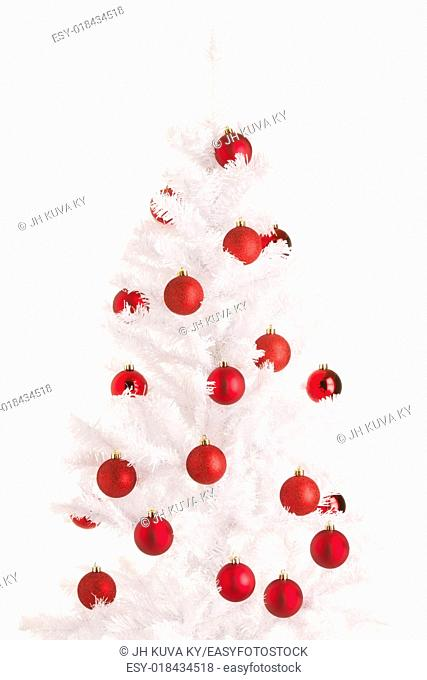 White Christmas tree and red balls, white background