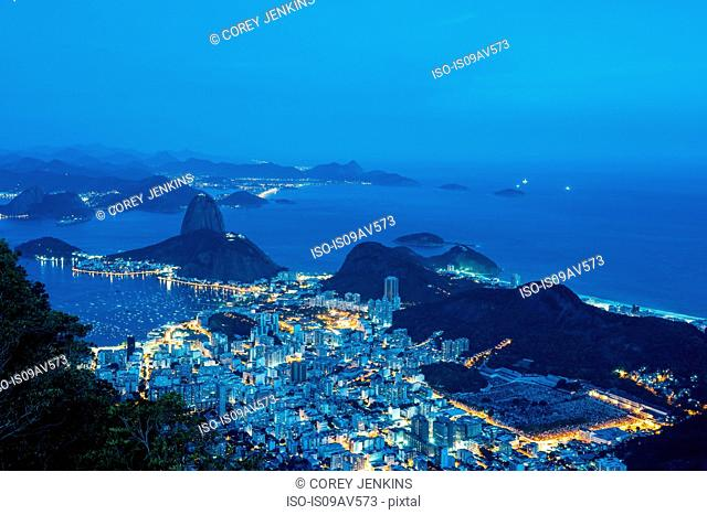 High angle view of Sugarloaf mountain illuminated at night, Rio de Janeiro, Brazil