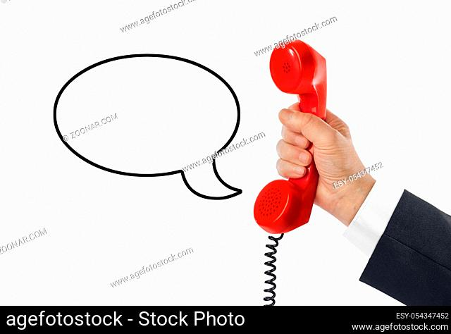 Telephone receiver in hand and speech bubble isolated on white background
