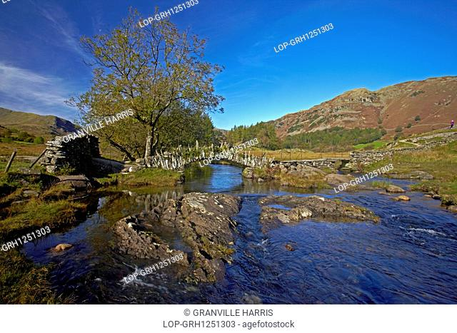 England, Cumbria, Skelwith Bridge. A view of Slater Bridge which crosses the River Brathay on its way from Little Langdale Tarn to Elterwater