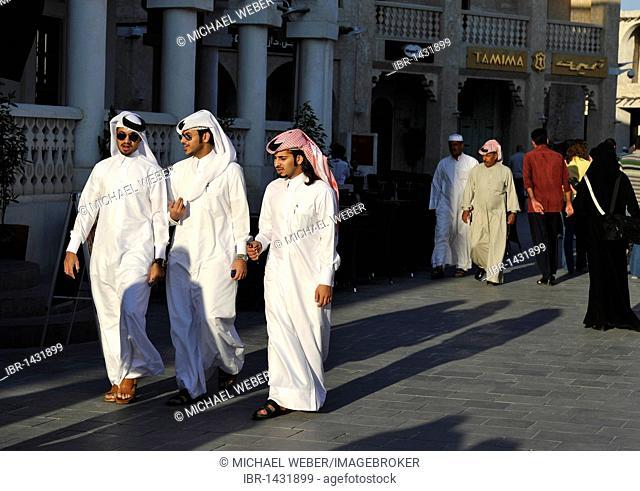 Qatari with ghutrah headdress strolling in the Souq al Waqif, oldest souq or bazaar of Doha, Qatar, Persian Gulf, Middle East, Asia