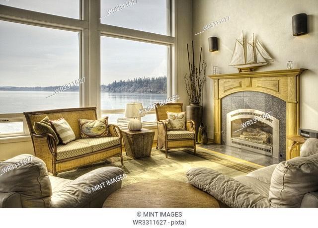 Luxury living room overlooking lake