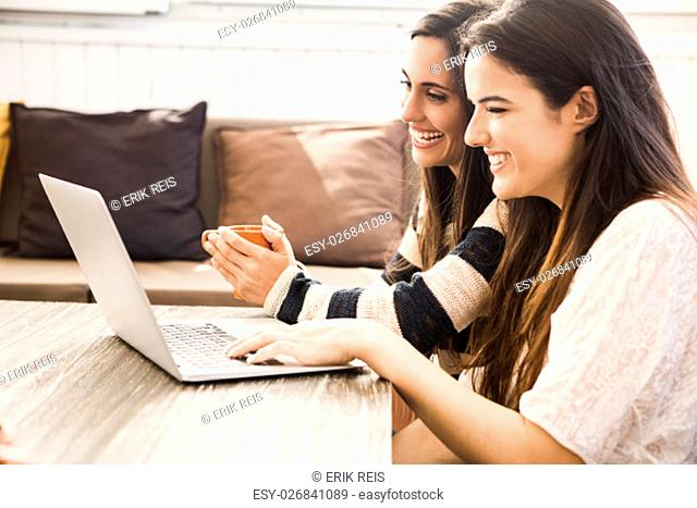 Female friends studying at the local coffee shop
