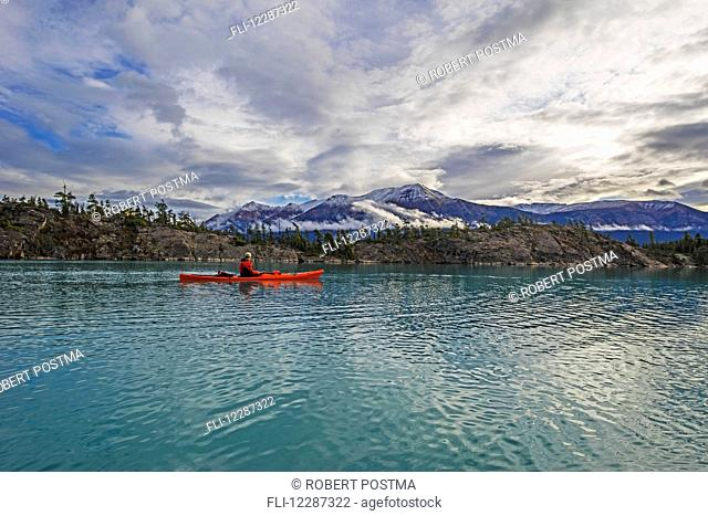 Kayaking on Atlin Lake; Atlin, British Columbia, Canada