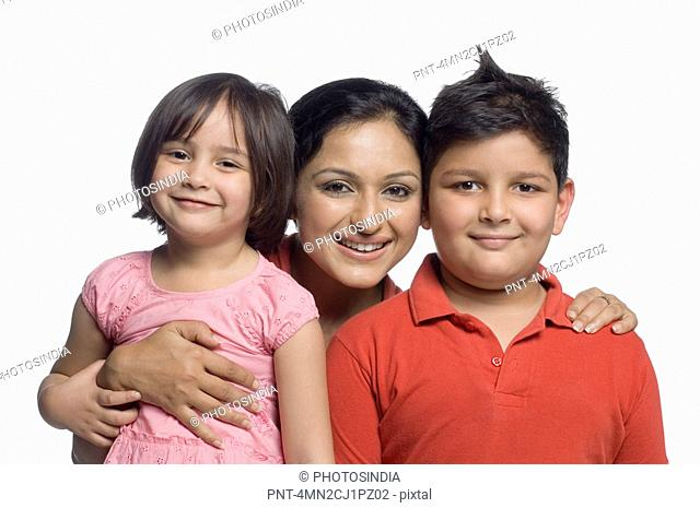 Portrait of a mid adult woman smiling with her son and daughter