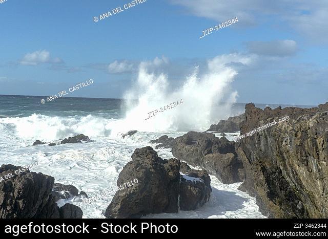 Foam waves on the rocky coast of Buenavista North of Tenerife island Spain