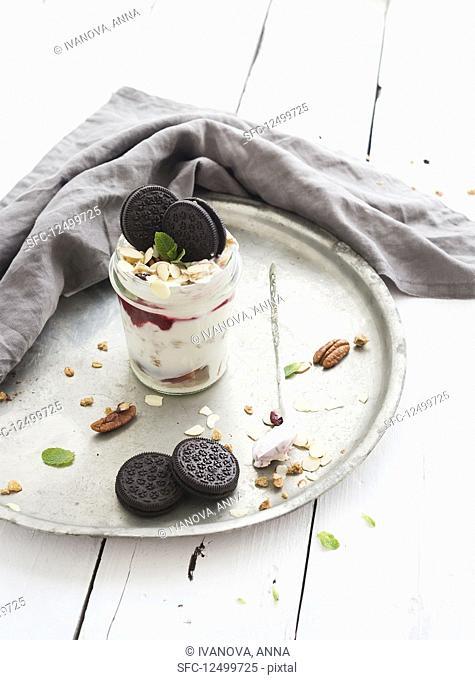 Yogurt oat granola with berries, honey, nuts and cookies