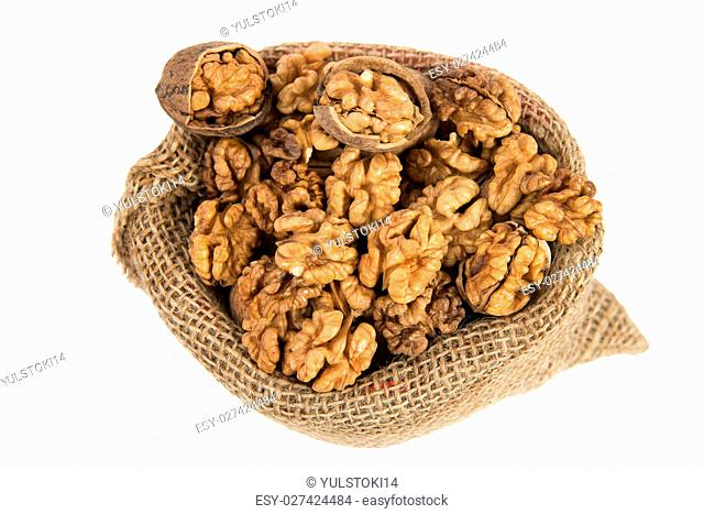 Walnuts in a bag on the white isolated background