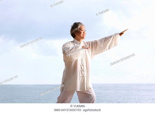 Older woman doing tai chi
